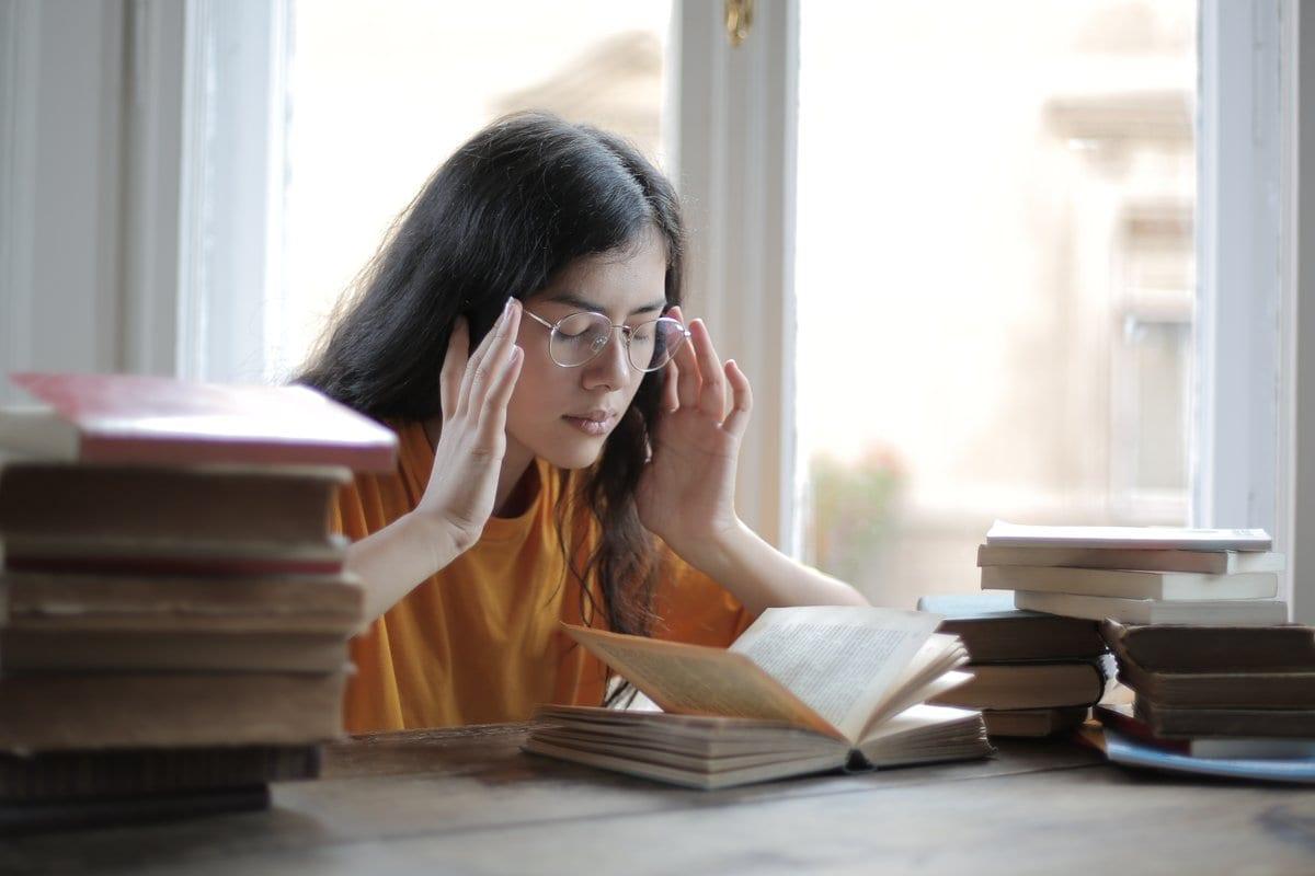 girl books headache
